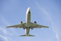 Plane overhead boeing. Plane boeing flying overhead with blue sky royalty free stock photo