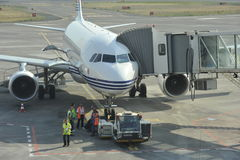 Plane parking at gate Stock Photography