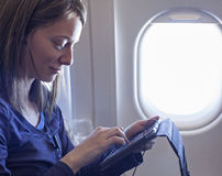 Plane Passenger In Airplane Using Tablet Stock Photography