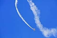 A plane performs aerobatics Royalty Free Stock Images