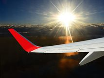 Flight to sun-shining sky. Success. Plain is in the beautiful sun-shining blue sky above the clouds and  stormy darkness. This is the unique picture of the day Royalty Free Stock Photos