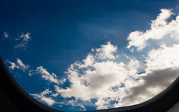 Plane porthole wonderful cloudscape view Royalty Free Stock Images