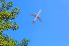 Plane prepare landing on blue sky Stock Images
