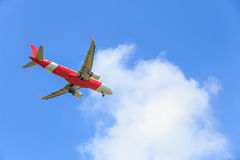Plane prepare landing on blue sky Stock Photography