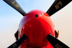 Plane Propeller. A view of a propeller with black blades on a red aircraft Stock Photography