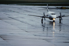 Plane In Rain. Aircraft on tarmac after landing in rain Stock Images