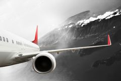 Plane red black white cloud travel transportion airplane mountains. Plane black white travel transportion airplane Stock Photography