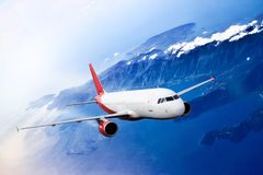 Plane red cloud travel transportion airplane mountains Stock Photo
