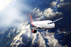 Plane red cloud travel transportion airplane mountains. Plane red cloud travel transportion airplane Royalty Free Stock Photo