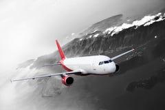 Plane red black white cloud travel transportion airplane mountains. Plane red cloud travel transportion airplane Stock Photos