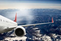 Plane red travel transportion airplane mountains. Plane black white travel transportion airplane Royalty Free Stock Photos