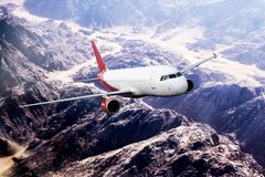 Plane red travel transportion airplane mountains. Plane black white travel transportion airplane Royalty Free Stock Photography