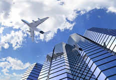 Plane reflecting on building. Plane reflecting on modern building facade while flying through the sky low angle shot Royalty Free Stock Photos