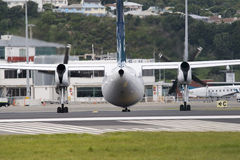 Plane on runway. Bombardier Q300 taxing to terminal Stock Photography