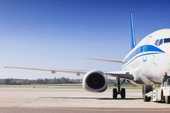 Plane on a runway in the airport. Beautiful view of plane on a runway in the airport Royalty Free Stock Images