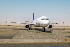 The plane is on the runway at the airport runway Stock Photography