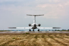 The plane on the runway. Back view stock photos