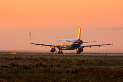 Plane on the runway. In the early foggy morning royalty free stock images