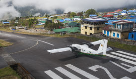 Plane on the runway at Lukla airport Stock Photo