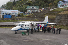 Plane on the runway at Lukla airport stock image