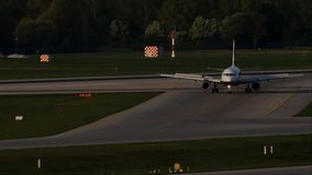 Jet plane taxiing in Munich Airport, MUC. Plane on runway in Munich Airport, MUC, spring stock video footage