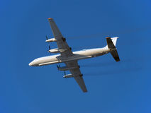 The plane. Russian turboprop passenger aircraft IL-18 in flight. Stock Image