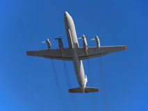 The plane. Russian turboprop passenger aircraft IL-18 in flight. Stock Images