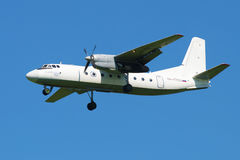 Plane An-24RV (RA-47800) airlines Pskov-Avia is landing in Pulkovo airport Royalty Free Stock Photography