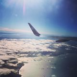 Air New Zealand plane`s wing flying over Tahiti royalty free stock images