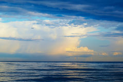 Plane, sea, thunderstorm Stock Image