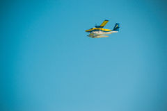 Plane or seaplane flying in sky, copy space Royalty Free Stock Photos