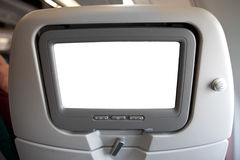 Plane seat with tv screen Royalty Free Stock Image