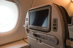 Plane seat with TV screen Stock Photography