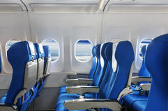 The plane seat and windows. Empty aircraft seats and windows Royalty Free Stock Photography