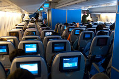 Plane seats. Modern plane seats with tv screens mounted royalty free stock image