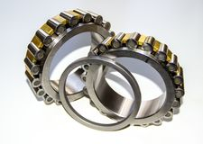 A plane shaft washer and two roller cages of a double-row tapered roller bearing hub unit with selective focus Royalty Free Stock Photo