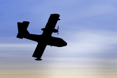 Plane silhouette. Silhouette of a propeller plane on a blue sky background stock photo