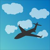 Plane silhouette in the sky Stock Photography