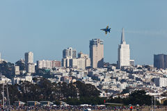 Plane Silhouetted Against San Francisco Skyline Stock Photos