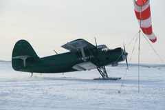 Plane with skis on the snow Stock Photo