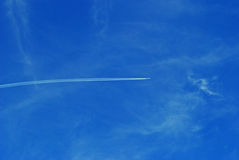 Plane in the sky background Royalty Free Stock Photo