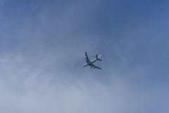 Plane on sky background. Flying airplane on the blue sky background Stock Images