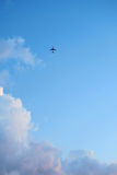 Plane in the sky with clouds Royalty Free Stock Photos