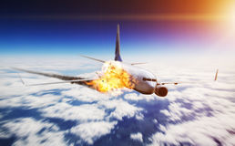 Plane in the sky with engine on fire Stock Photo