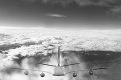 Plane in the sky flight travel transport airplane background black white Stock Photo