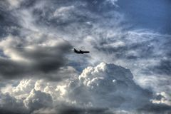 Plane in Sky. Plane flying in sky thru clouds Royalty Free Stock Photo