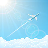 Plane in the sky over clouds Stock Photos