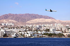 Plane  in the sky over Eilat Stock Photography
