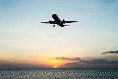 Plane with sky sunset and sea Royalty Free Stock Photography