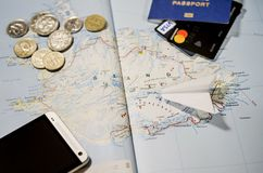 The plane, smartphone, biometric passport, dollars, coins and credit cards lie on a map royalty free stock images